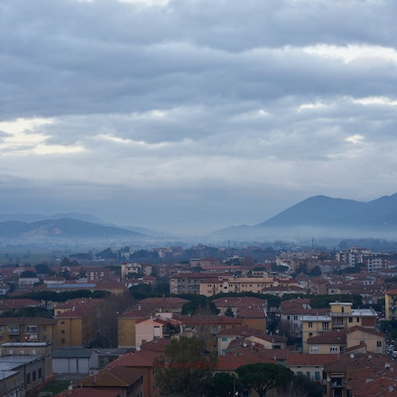 The Tuscan hills at sunset from the Leaning Tower. - Pisa