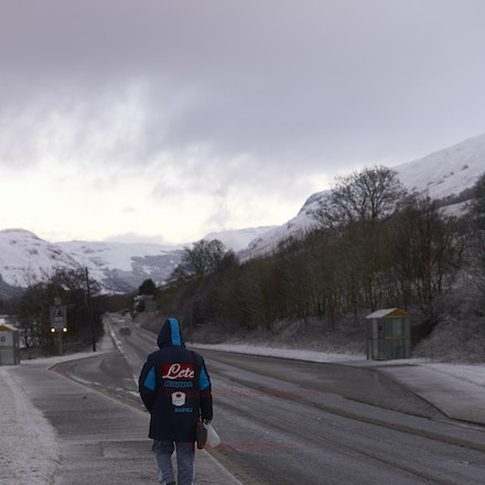 A long way from Napoli! - A young man headed to work, Cairndow, Argyll  (File: L9997656)