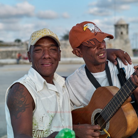 Malecón Musicians - We were serenaded by these busking musicians. It was difficult getting shots at minimum focus distance while this was happening; a...