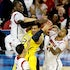 Surrounded - Michigan's Jordan Morgan (52) is surrounded by Louisville Cardinals defenders during second-half action in the NCAA Tournament final at the...