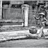Bali Street, Early Morning  - The hard day starts for this lady. Denpasar.