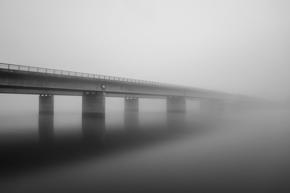 Foggy Dawn - Long exposure of Commonwealth Ave dual bridges crossing Lake Burley Griffin on a foggy morning.