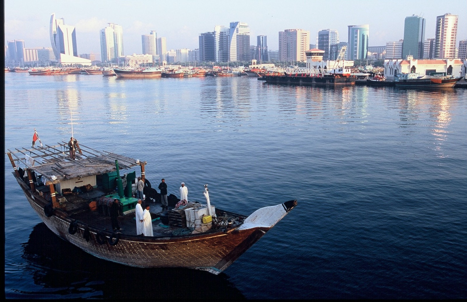 On The Way. - A Dhow (a Middle Eastern Cargo Ship) leaves the Dubai harbor (locally known as the creek) on its way to Pakistan to pick up goods to be delivered...