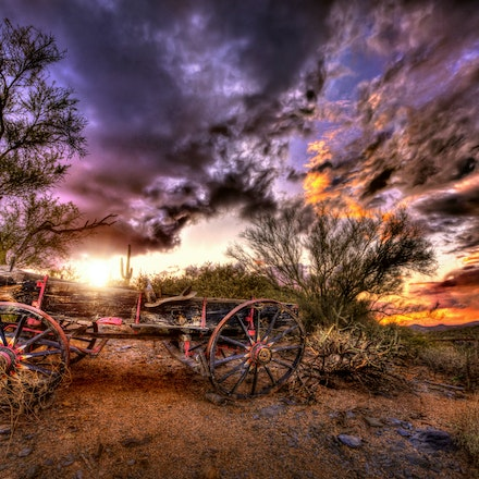 Pink Accents 2.23.2018.11 - Pink Accents. Every color of the rainbow is visible in this image of an old wagon resting among desert trees and bushes in...