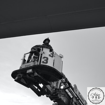 Into The Danger - Maryland, USA, July 10, 2014: A Company 33 Volunteer Firefighter moves up to the roof to fight a fire.